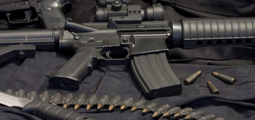 M4 Rifles along with side arm, knife, and ammunition belt sit at the ready