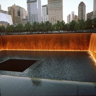 New York City, USA - June 24, 2014: 9/11 Memorial at Ground Zero, Lower Manhattan, commemorating the terrorist attack of September 11, 2001.