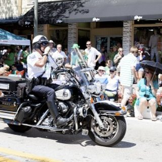 A policeman on a motorcycle takes part in the annual St. Patrick's Day parade.