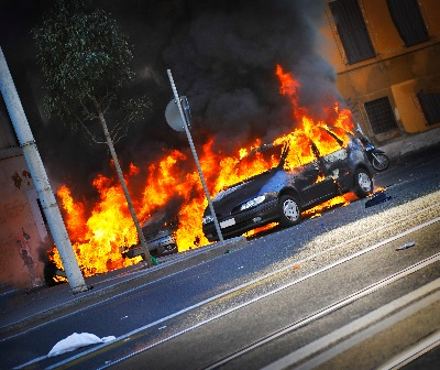 angled picture of a car on fire