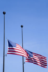 US Flag Fly at Half Mast in Remembrance