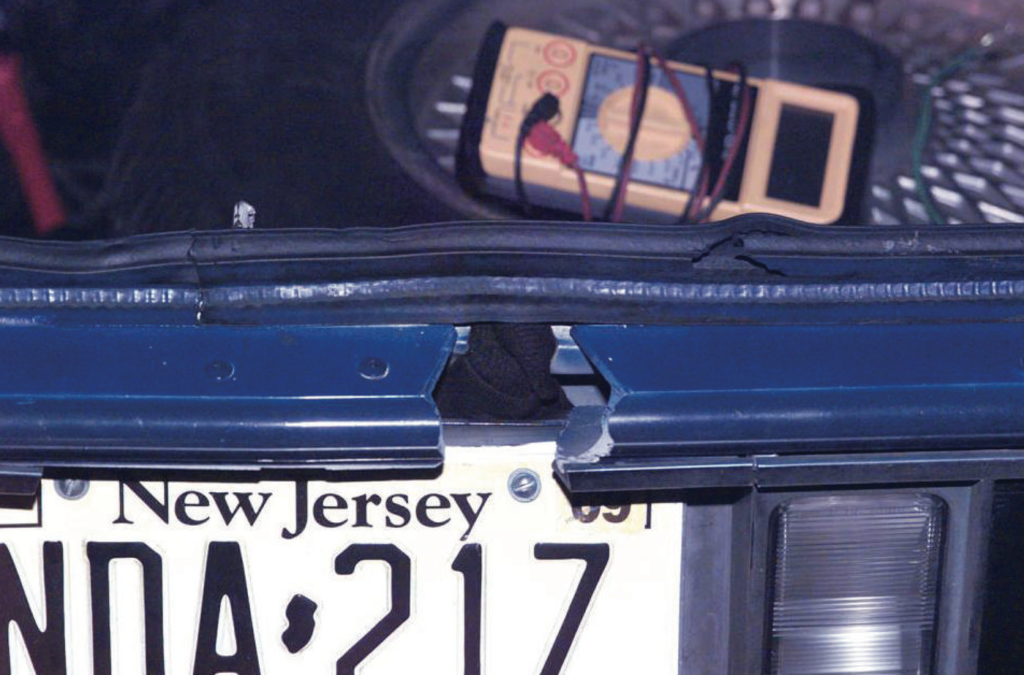 Hole in the trunk of the D.C. sniper's car used to shoot victims.