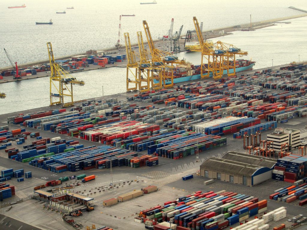 Containers and ships at a busy port.