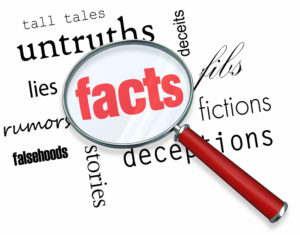 Magnifying glass of 'facts' with lies around it