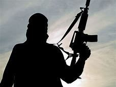 silhouette of a soldier holding machine gun