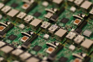 Close-up photo of green capacitors chip circuit boards
