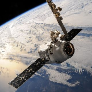 small space craft over the earth surface in space