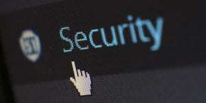 A close up image of a computer screen shows the word Security, and a cursor hovering over it