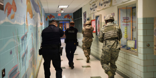 Members of the 436th Security Forces Squadron clear rooms during an active shooter exercise Feb. 26, 2018, at the George S. Welch Elementary School and Dover Air Force Base Middle School on Dover AFB, Del. Security Forces has developed a strong relationship with local and state police departments by hosting joint exercises where all units benefit. (U.S. Air Force photo by Airman 1st Class Zoe M. Wockenfuss)
