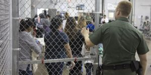 U.S. Border Patrol agents conduct intake of illegal border crossers at the Central Processing Center in McAllen, Texas, Sunday, June 17, 2018.