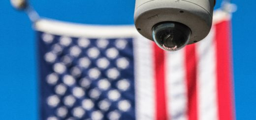 surveillance camera with american flag in background