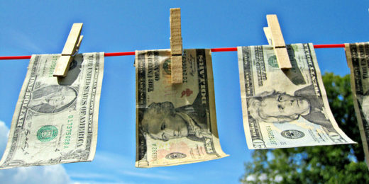money hanging on laundry line