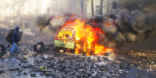 burning vehicle, street violence