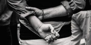 hands tied behind back