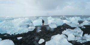 melting ice blocks on black sand beach