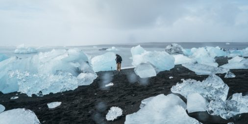 melting ice blocks on black sand beach