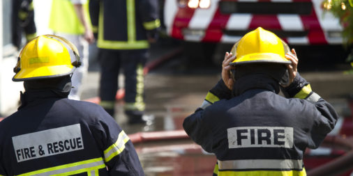 Firefighter brigade at work. Shallow depth of field.