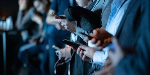 people looking at their phones