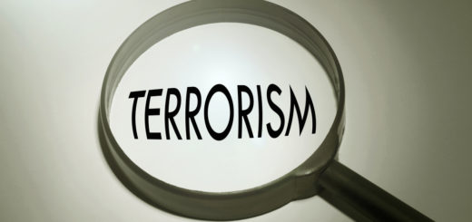 Terrorism is given a closer look in this photo of a magnifying glass covering the word terrorism.