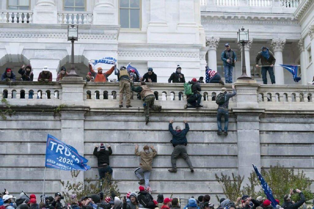 MAGA Mob scales walls at Capitol Building