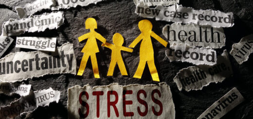 Image of Paper cut-outs of a family of three surrounded by Coronavirus and economic related news headlines with the word Stress in red