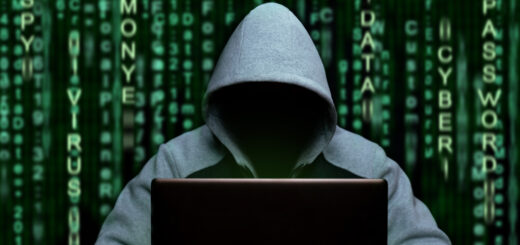 This image portrays a hacker at the computer, relating to cyber espionage and digital security