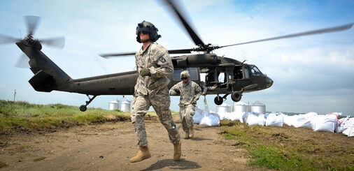 Missouri National Guard soldiers airlift sandbags with a black hawk helicopter