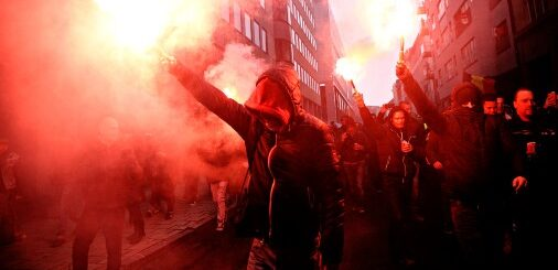 Extremists lighting up flares during a protest.