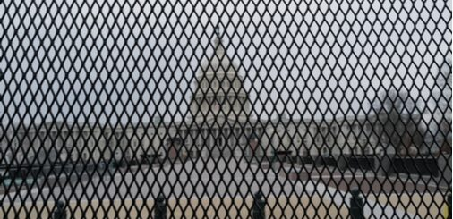 capitol building behind fence