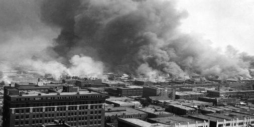 Buildings on fire on Black Wall Street, Tulsa, OK 1921
