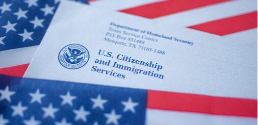 USCIS envelope amongst US flags