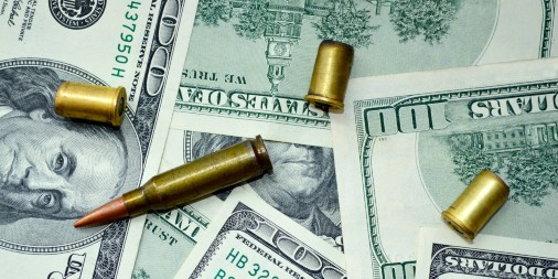 Cartridges for weapons on 100 dollar bills on