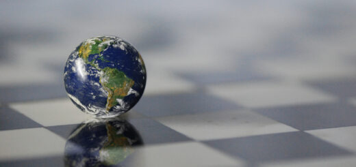 This image portrays a globe on a chessboard